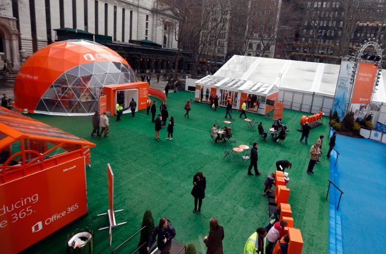 People stroll through Citi Pond Bryant Park in New York and explore ways the new cloud service helps them get more done.