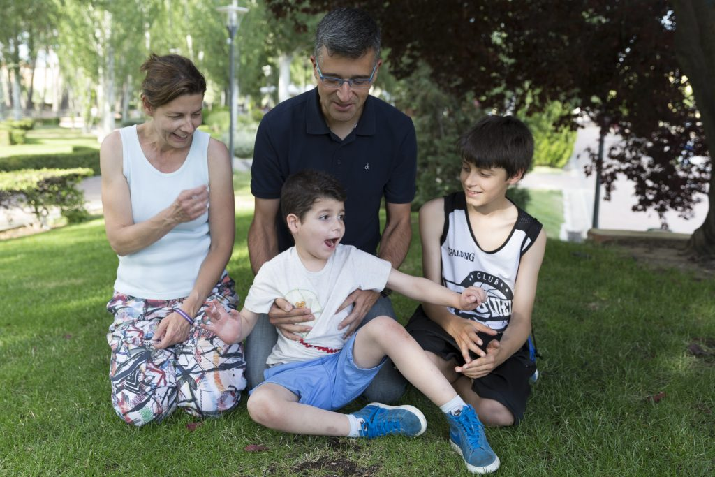 """Sergio, center, and his family. His father, Julian, says Sergio is a happy child """"who enjoys everything he does."""""""