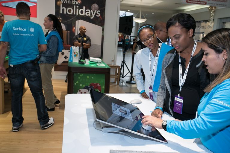 Customers try the new Microsoft Surface Studio at the Microsoft Store at Town Center at Boca Raton in Boca Raton, Fl., on Nov. 3, 2016.