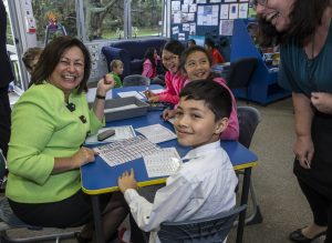 Minister for Education, Hon. Hekia Parata with students learning computational thinking through the CS Unplugged program.