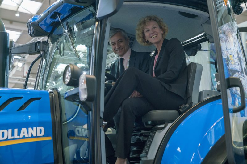 Jean-Philippe Courtois, EVP and President, Microsoft Global Sales, Marketing & Operations, and Sabine Bendiek, Area Vice President, Microsoft Germany, in the cab of CNHi's T7 Tractor.