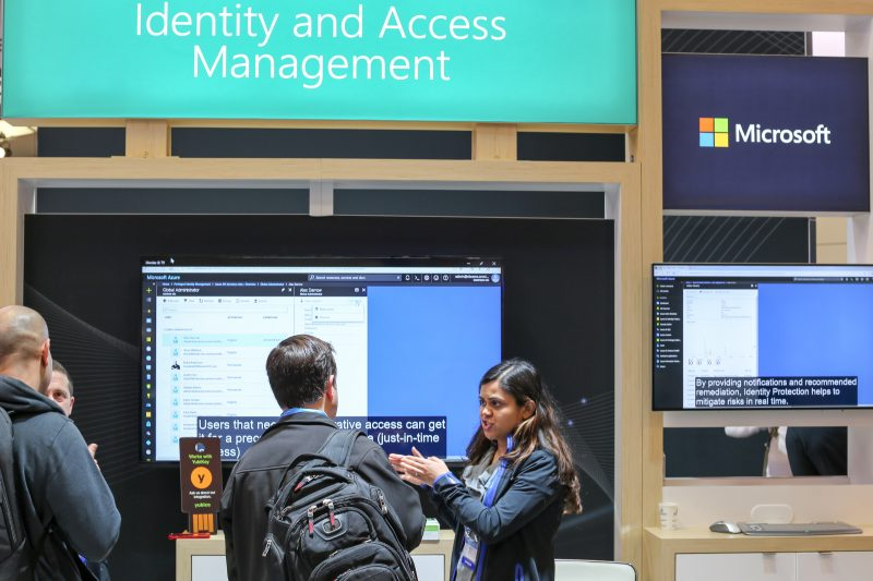 A Microsoft spokesperson speaks to attendees at the Microsoft booth at RSA on April 17, 2018.