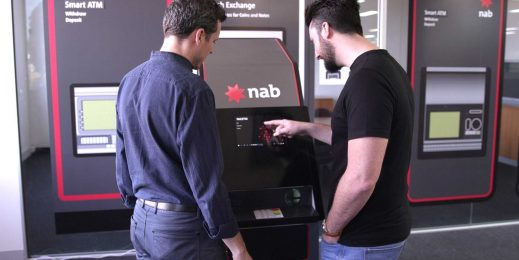 two men using a NAB ATM