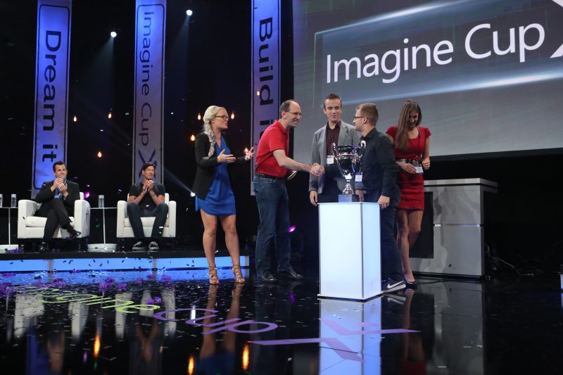 Microsoft Executive Vice President of Cloud and Enterprise Scott Guthrie and Imagine Cup Master of Ceremonies Kate Yeager congratulate the new champions, X.GLU of the Czech Republic, on their victory.