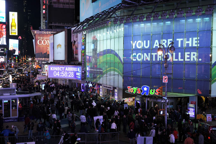 """A crowd of people line up to be among the first to buy Kinect for Xbox 360 at midnight at the Toys """"R"""" Us store in Times Square. New York City, November 3, 2010."""