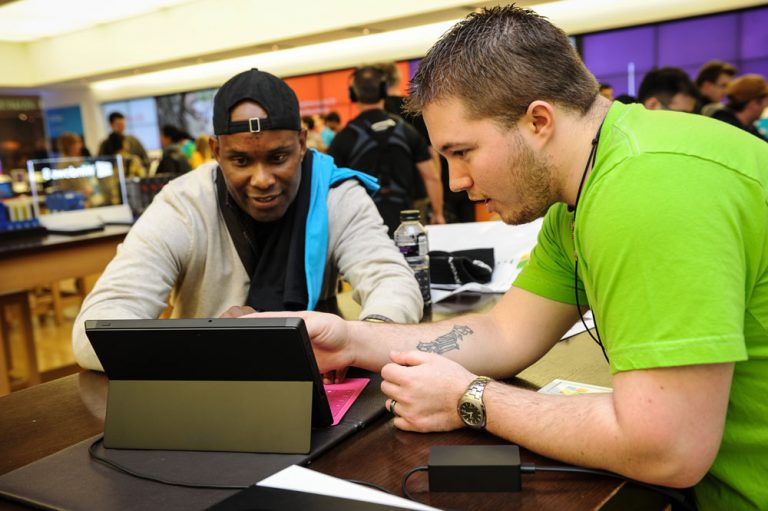 A customer gets a Surface 2 tutorial from a Bellevue Square Microsoft Store associate in Bellevue, Wash.