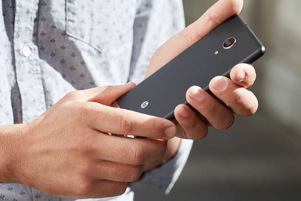 A man holding a HP Commercial Phablet.