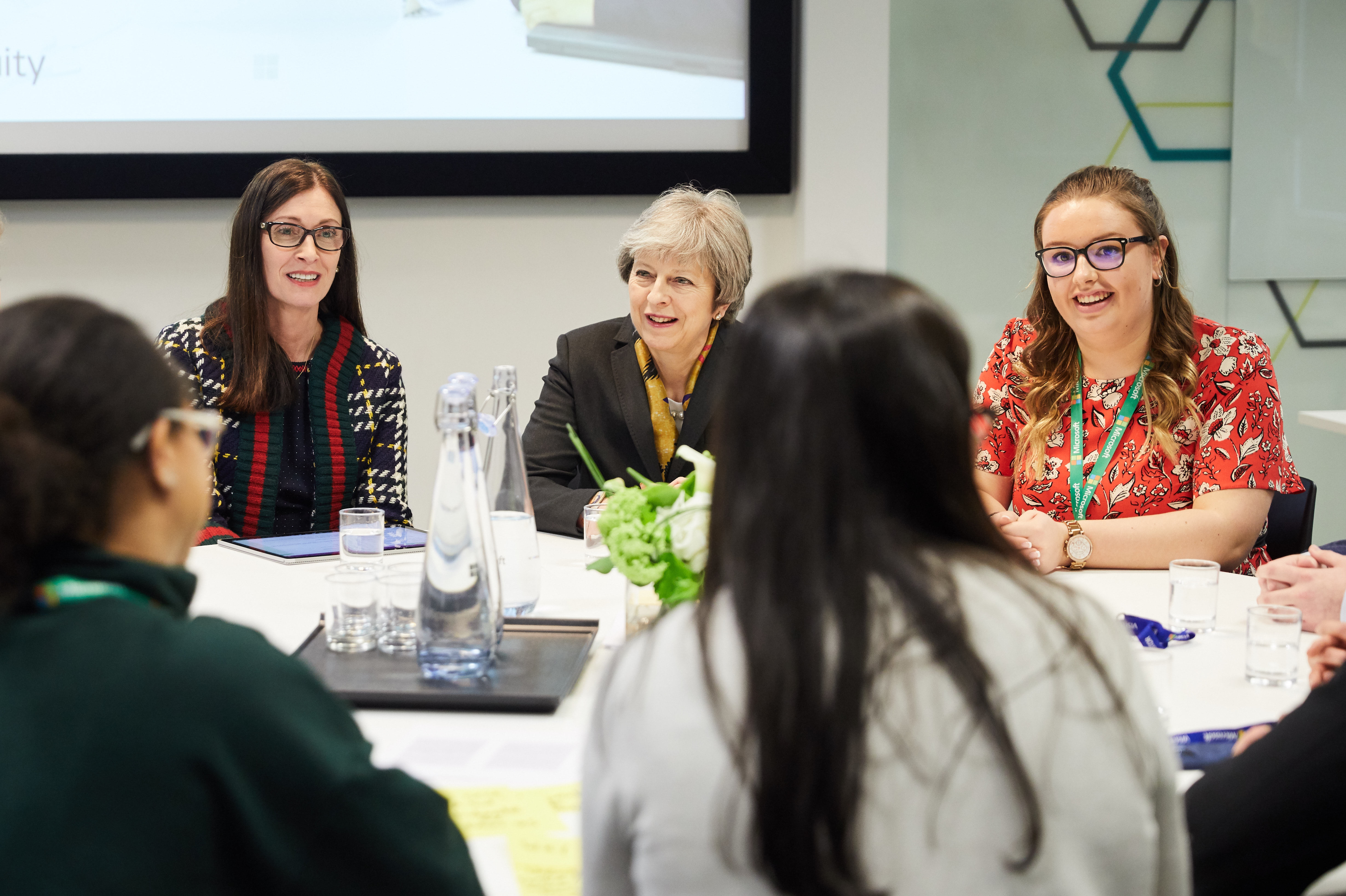 Prime Minister Theresa May and Cindy Rose, Chief Executive of Microsoft UK, with Microsoft apprentices