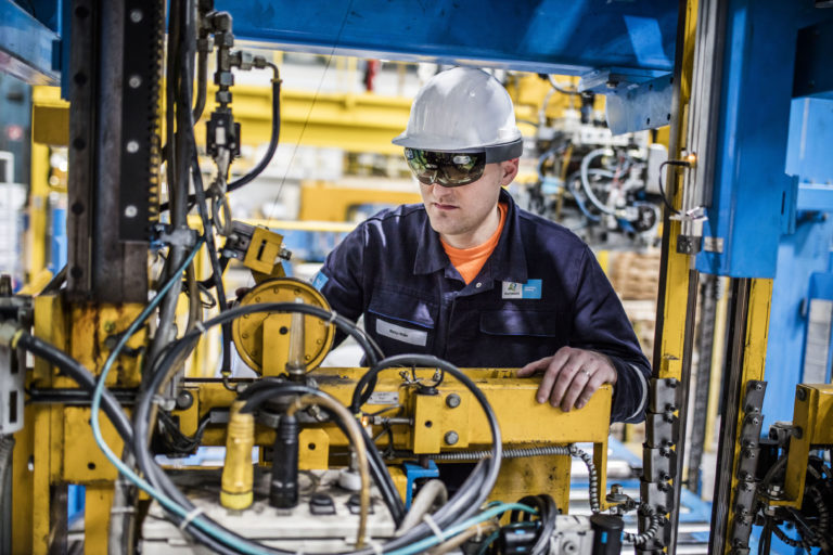 Engineers using HoloLens on the factory floor