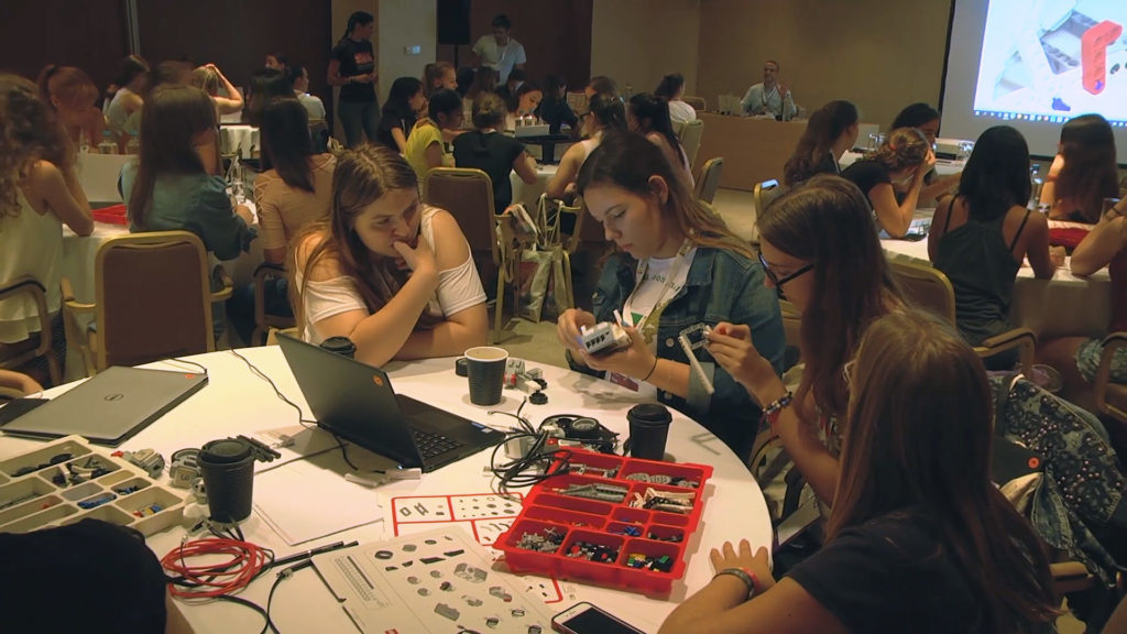 Teenage girls participating in hackathon