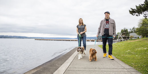 Craig and Melissa Cincotta walk their two dogs near a large lake