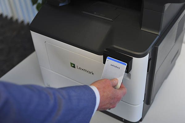close-up of a badge swipe in front of a printer