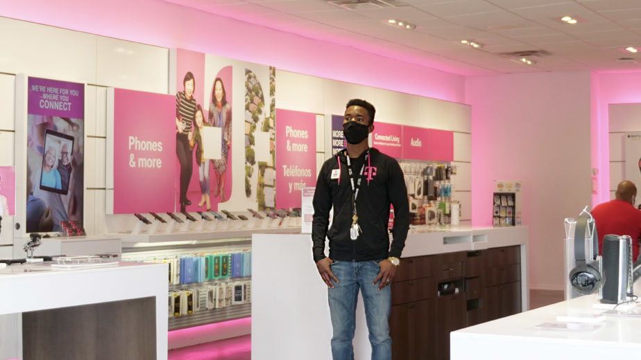 T-Mobile employees at a store set up for safety
