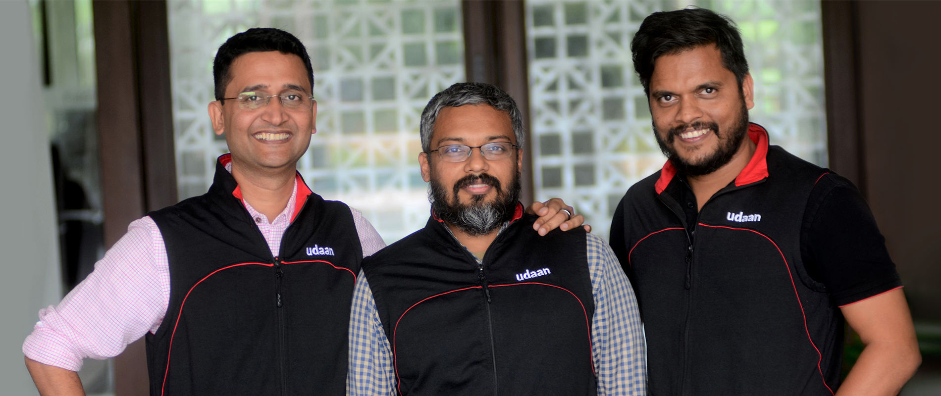 From left to right, Amod Malviya, Vaibhav Gupta and Sujeet Kumar, co-founders of Udaan, similing at the camera
