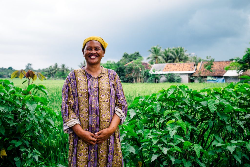 Woman smiling in Indonesian rice field
