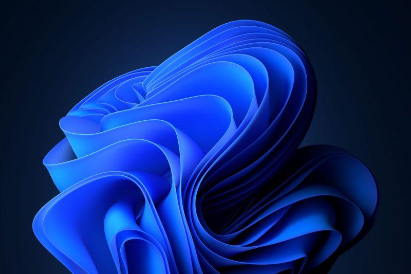 Screenshot of abstract ribbon computer desktop screensaver in dark mode