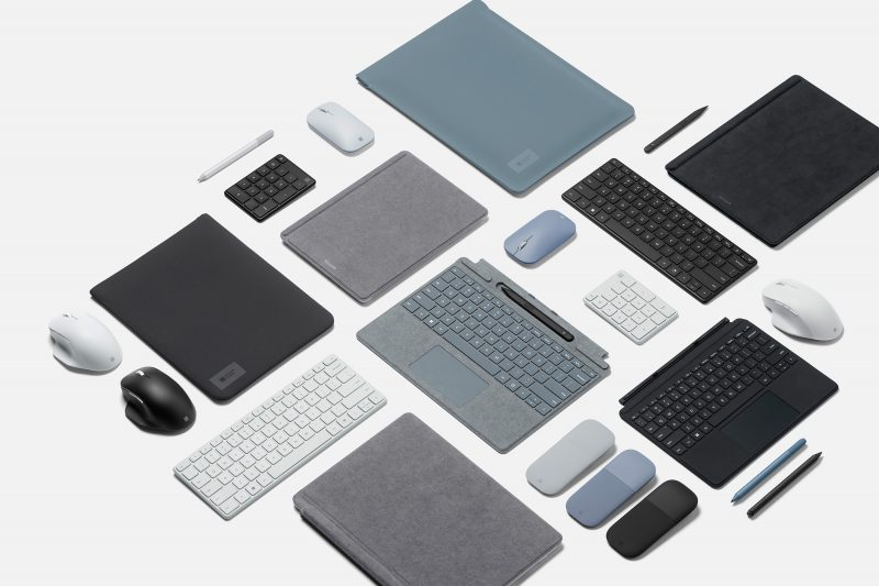 An aerial view of Surface Pro 8 devices with accessories