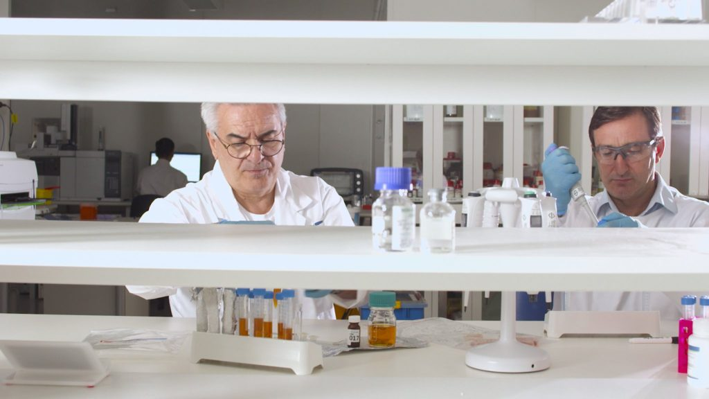 Clinical researchers working in a lab