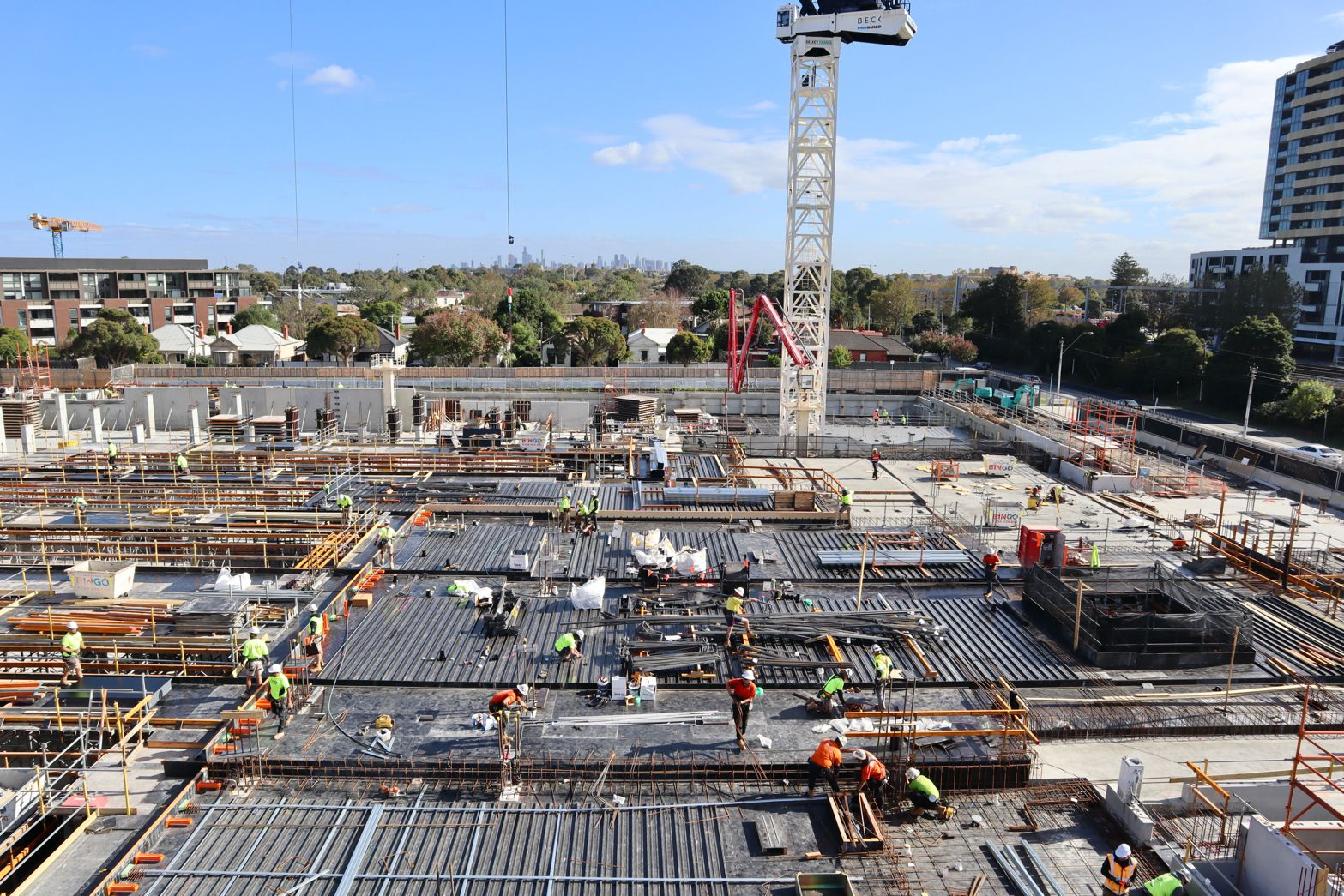 Wide shot of construction workers on site