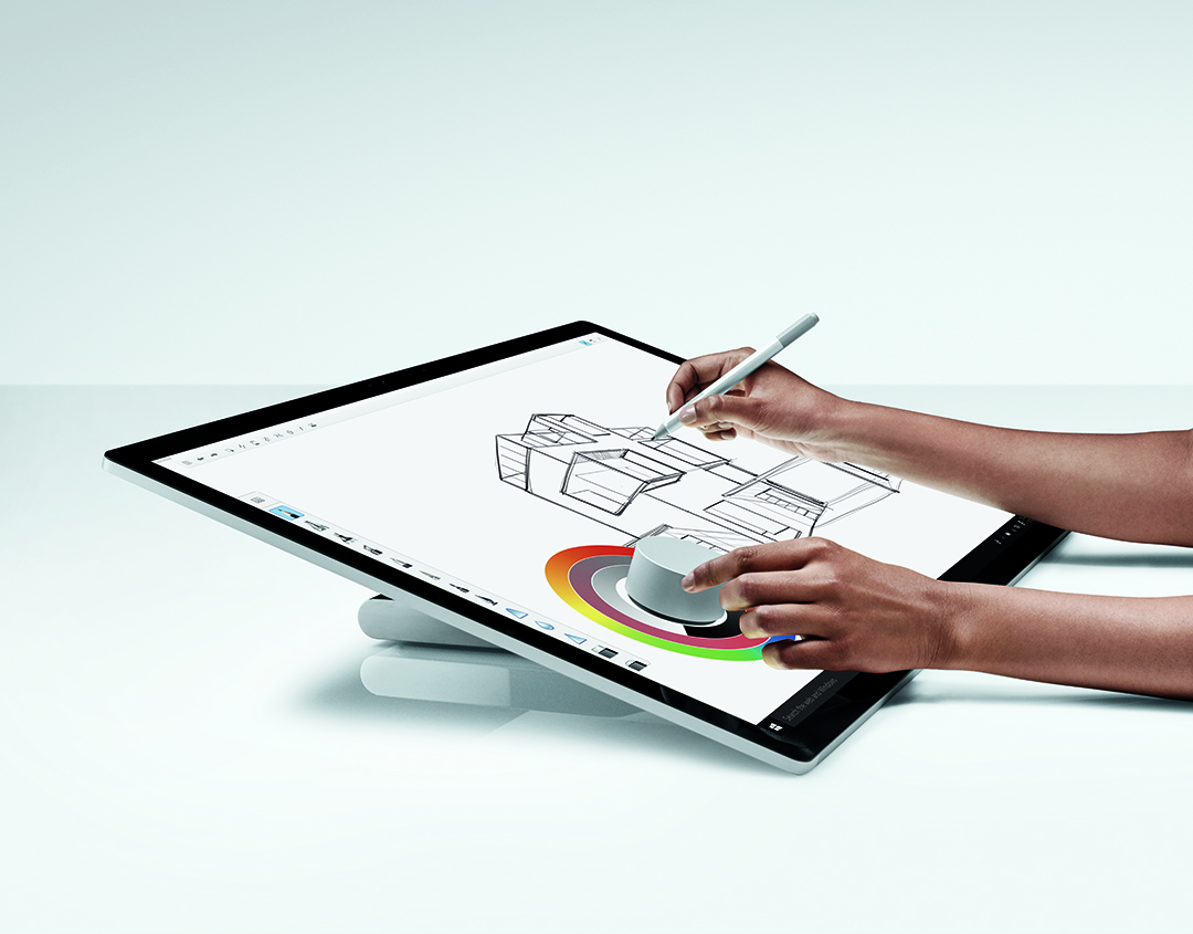 Woman using Dial and Pen on a Surface Studio
