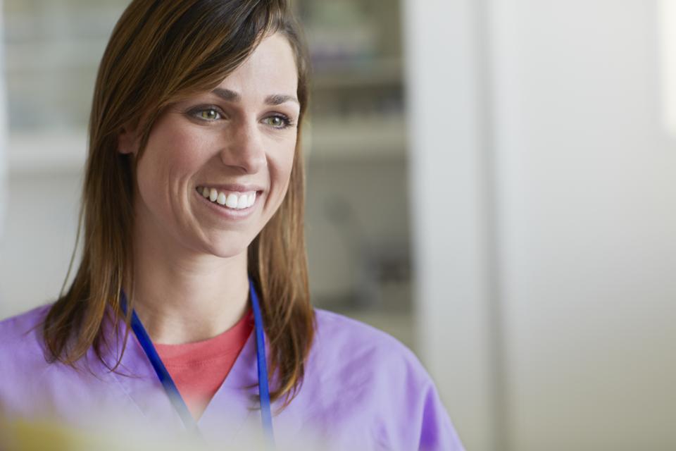 A nurse smiling in a hospital
