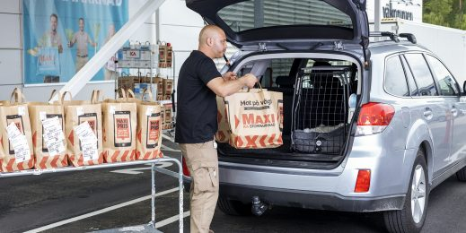 Man places groceries in back of car