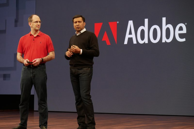 Abhay Parasnis, Adobe's executive vice president and chief technology officer on stage with Scott Guthrie (left) at Microsoft Build 2017