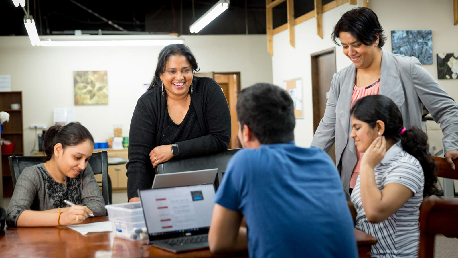 Kal Viswanathan and her students; Photo by Scott Eklund/Red Box Pictures